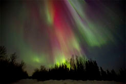 aurora borealis northern lights photo with red