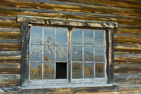 tetons reflected in window